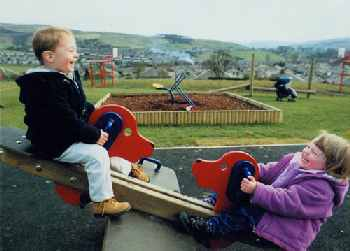 laughing children on seesaw