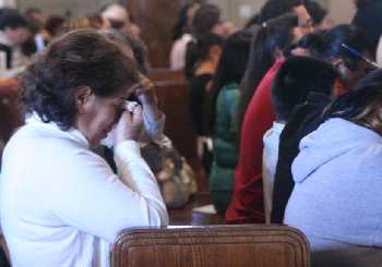 woman crying with grief in church