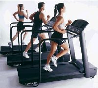 people exercising on treadmills