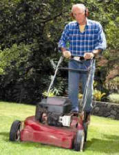 man mowing grass