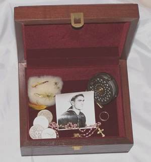 wooden memory box with mementos of lost man
