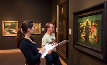 couple looking at artwork in museum