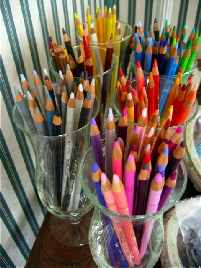jars of colorful artists pencils