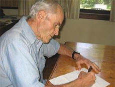 man writing to express his grief