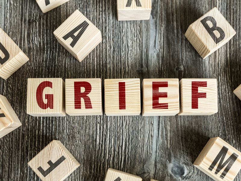 Wooden blocks that spell grief