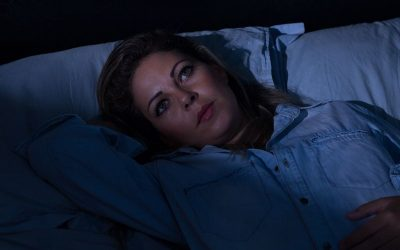 Girl laying in bed with insomnia