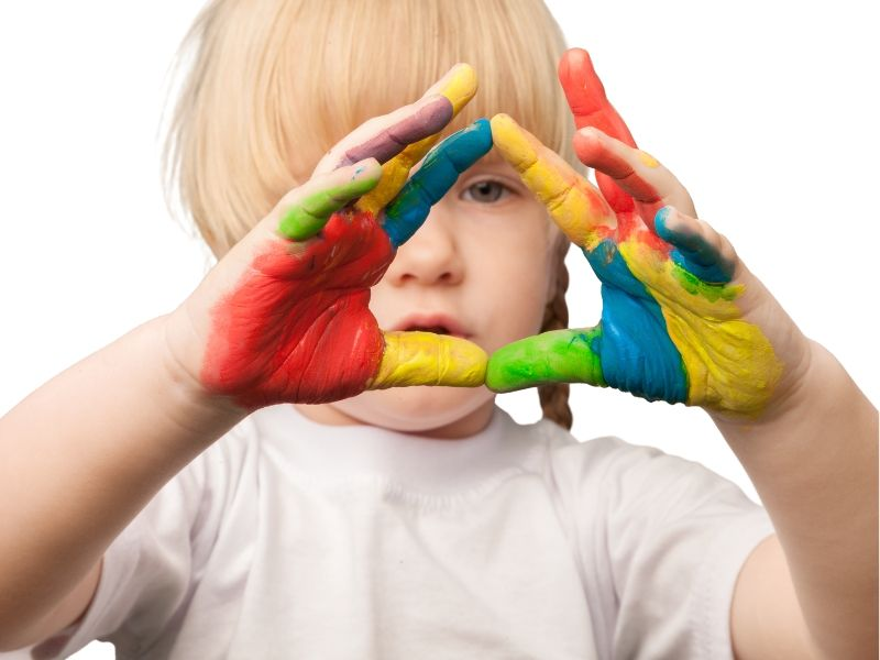 Child with paint on their hands from fingerpainting