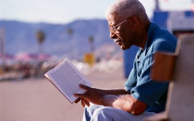 Man reading a grief and loss book