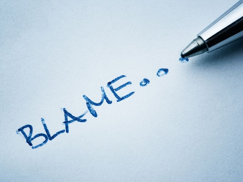 The word blame written on a piece of paper