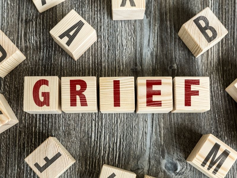 The word grief spelled with scrabble tiles