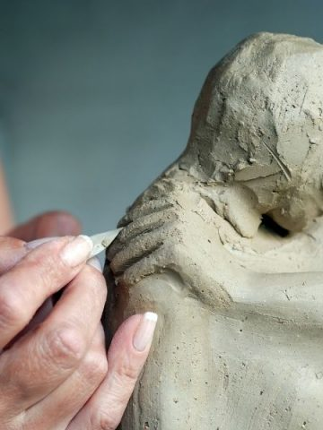 A woman working on a sculpture