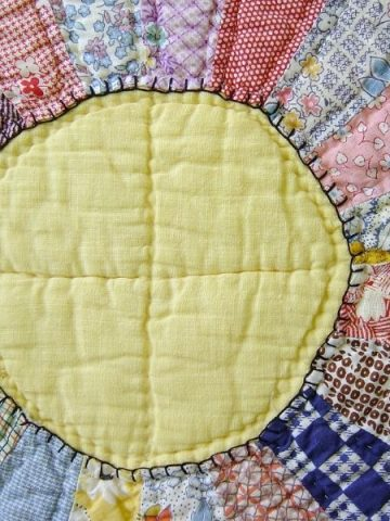 Quilt with a sun in the middle